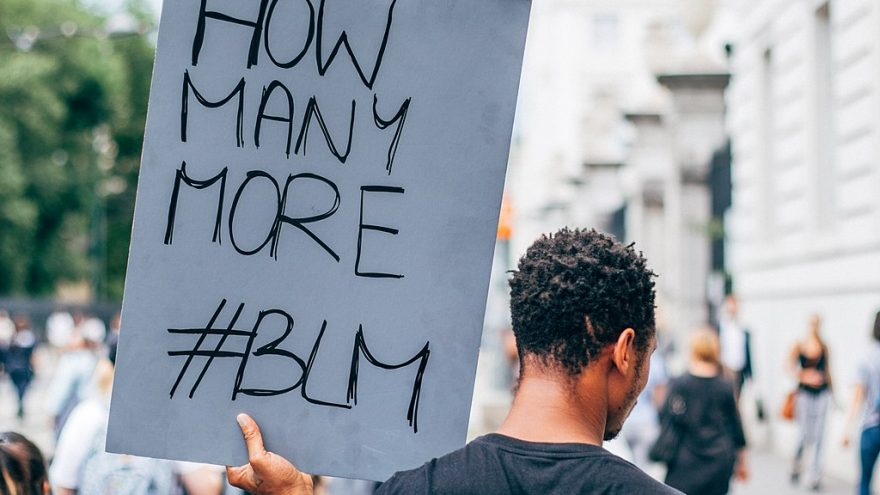 https://commons.wikimedia.org/wiki/File:Black_Lives_Matter,_black_man_holding_a_sign_with_How_Many_More_-BLM_message_(50114576608).jpg