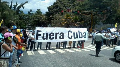 https://commons.wikimedia.org/wiki/File:Cuba_Out_Sign_Venezuela_2014.jpg